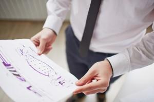 Image of sketch in businessman hands